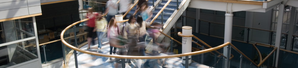 Blurred image of people on a staircase at Sheffield Hallam University